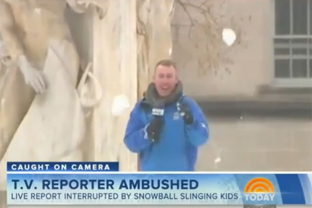 Reporter caught in snowball fight