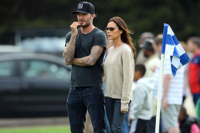 David and Victoria Beckham join parents on touchline to watch Romeo and Cruz