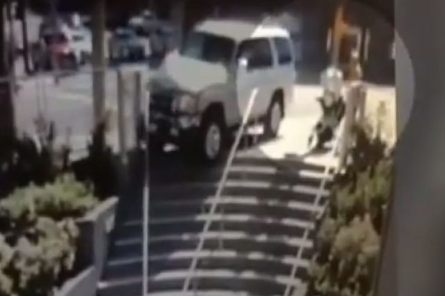 Terrifying moment car hurtles towards mum and baby (video)