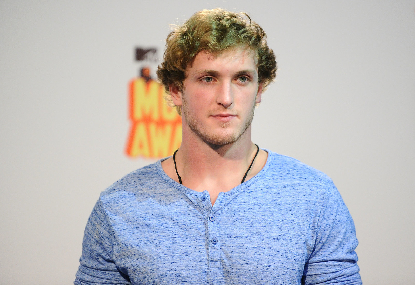 LOS ANGELES, CA - APRIL 12:  Logan Paul poses in the press room at the 2015 MTV Movie Awards at Nokia Theatre L.A. Live on April 12, 2015 in Los Angeles, California.  (Photo by Jason LaVeris/FilmMagic)