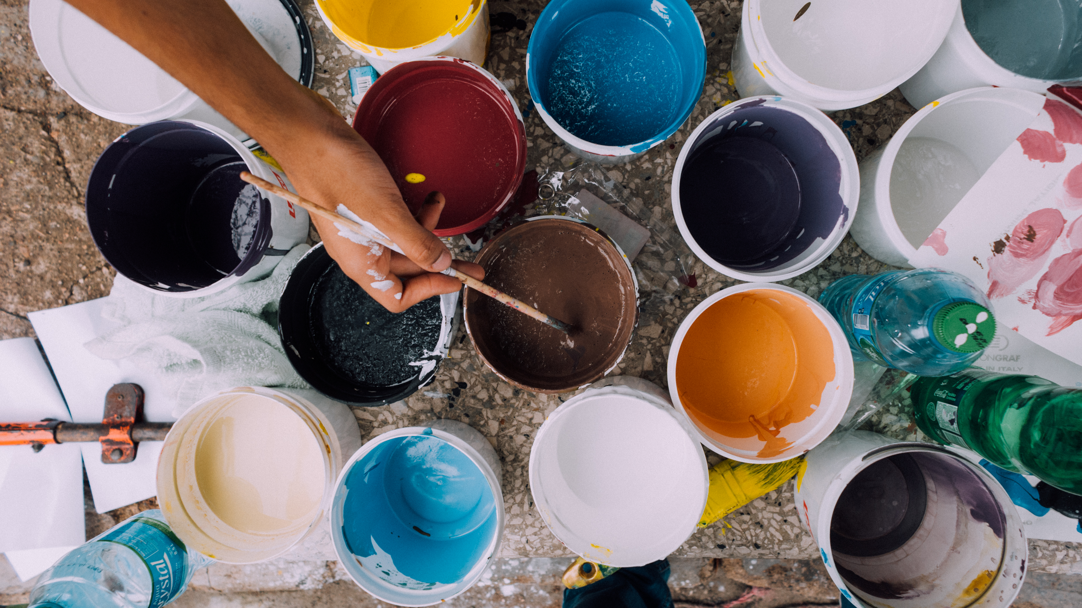 paint-brushes-and-pots-on-table