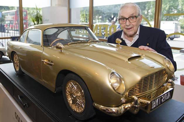 Gold-plated Aston Martin DB5 model with Sir ken Adam