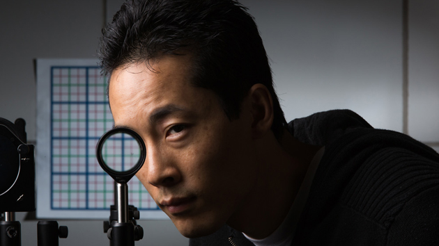 University of Rochester's lens-based cloak tested by student Joseph Choi