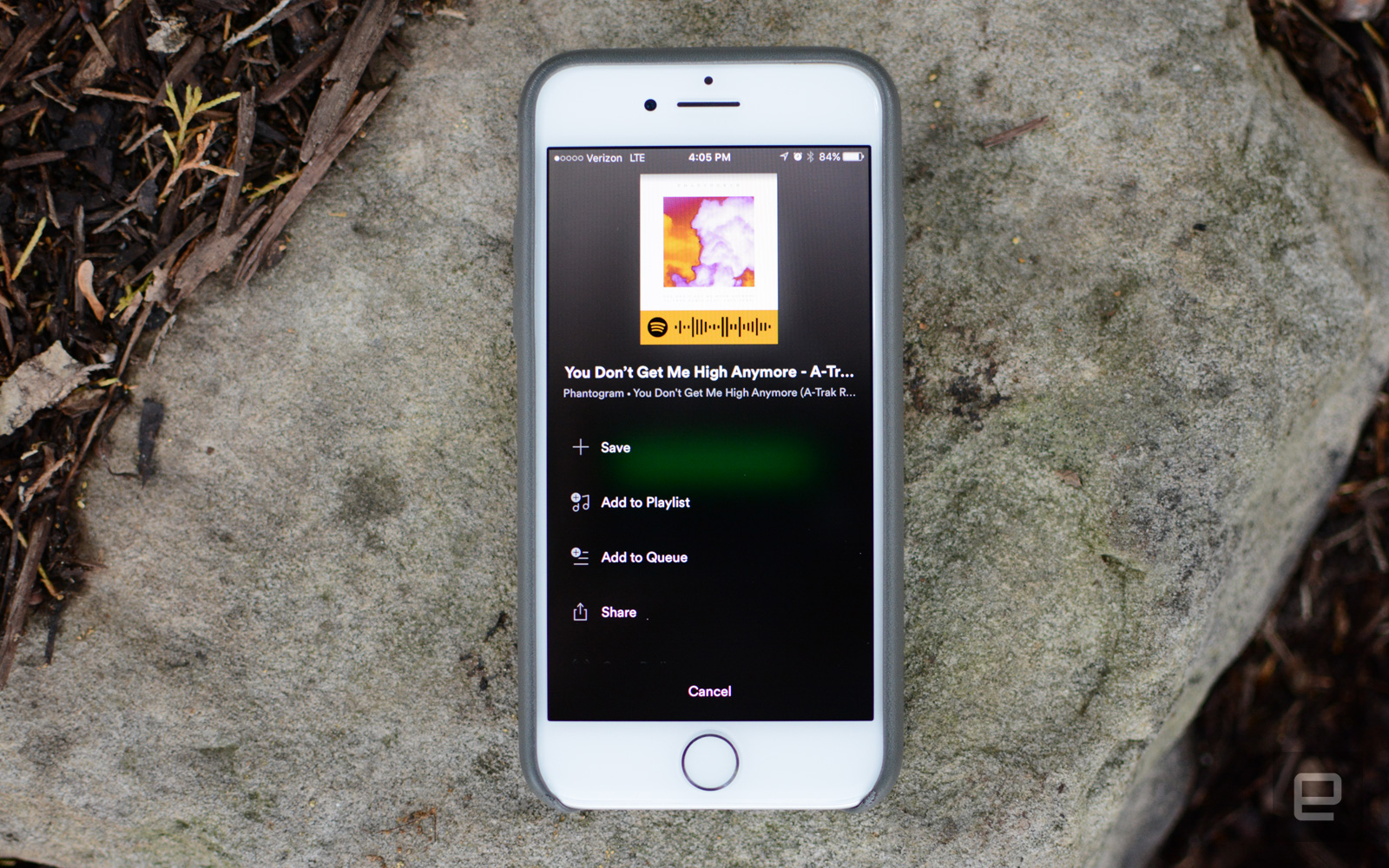 Photo of an iPhone showing a Spotify code for a song.