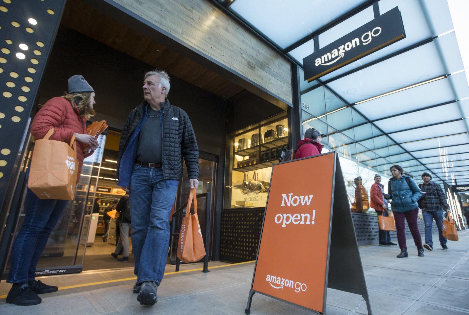 SEATTLE, WA - JANUARY 22: A shopper walks out the the Amazon Go store, on January 22, 2018 in Seattle, Washington. After more than a year in beta Amazon opened the cashier-less store to the public. (Photo by Stephen Brashear/Getty Images)