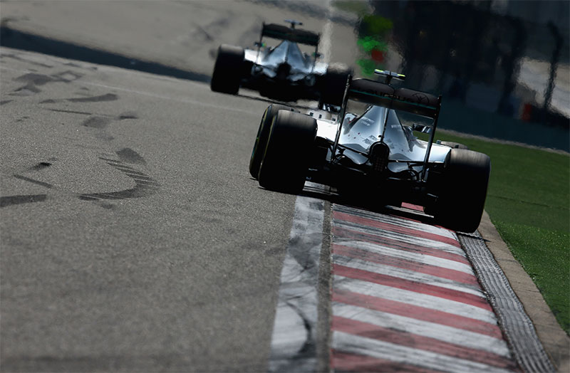 Nico Rosberg trails Lewis Hamilton during the 2015 Chinese F1 Grand Prix.