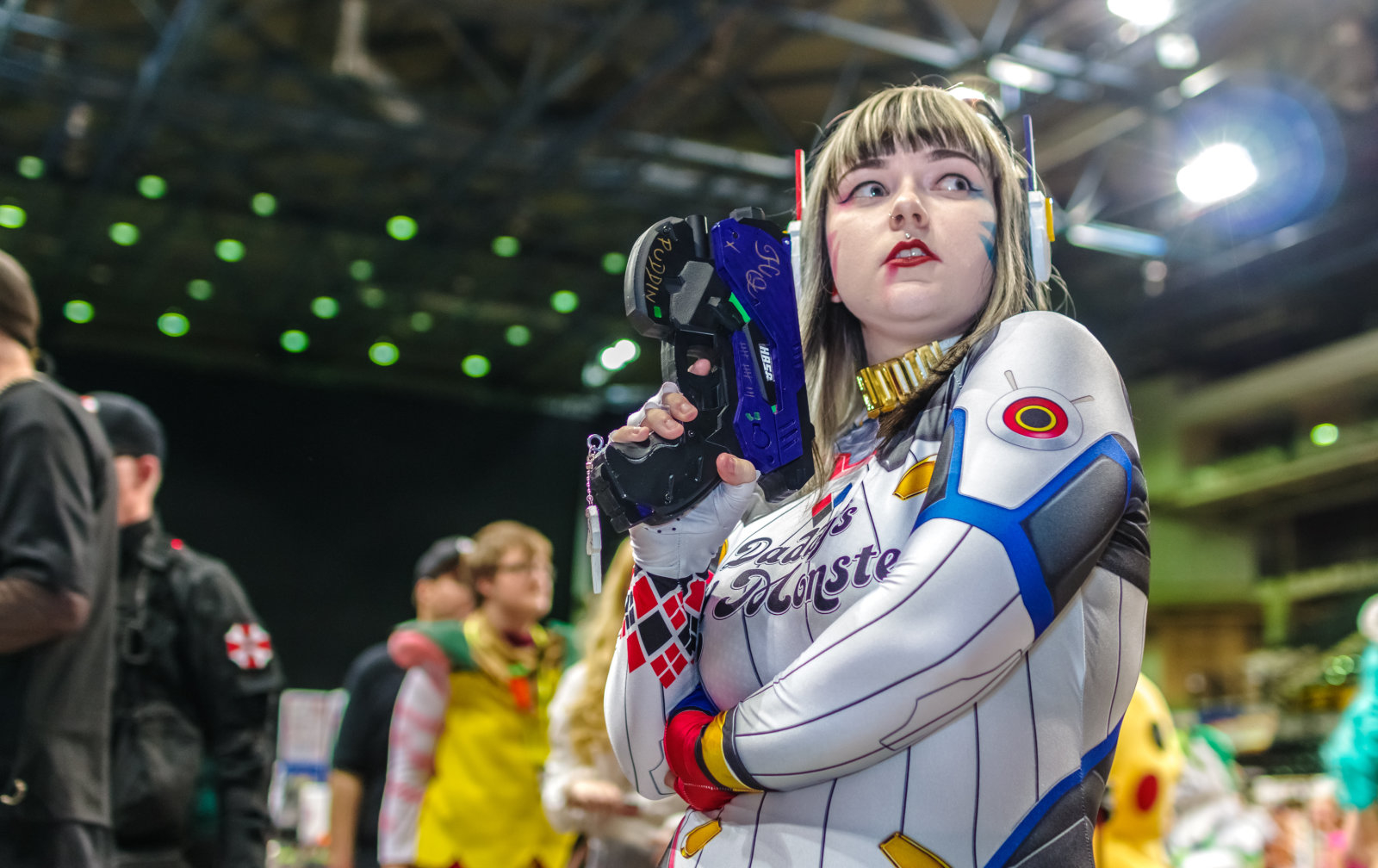 Cosplayer dressed as a mashup cosplay of 'D.Va' from the video game Overwatch and Harley Quinn from DC Comics at the Yorkshire Cosplay Con at Sheffield Arena.
