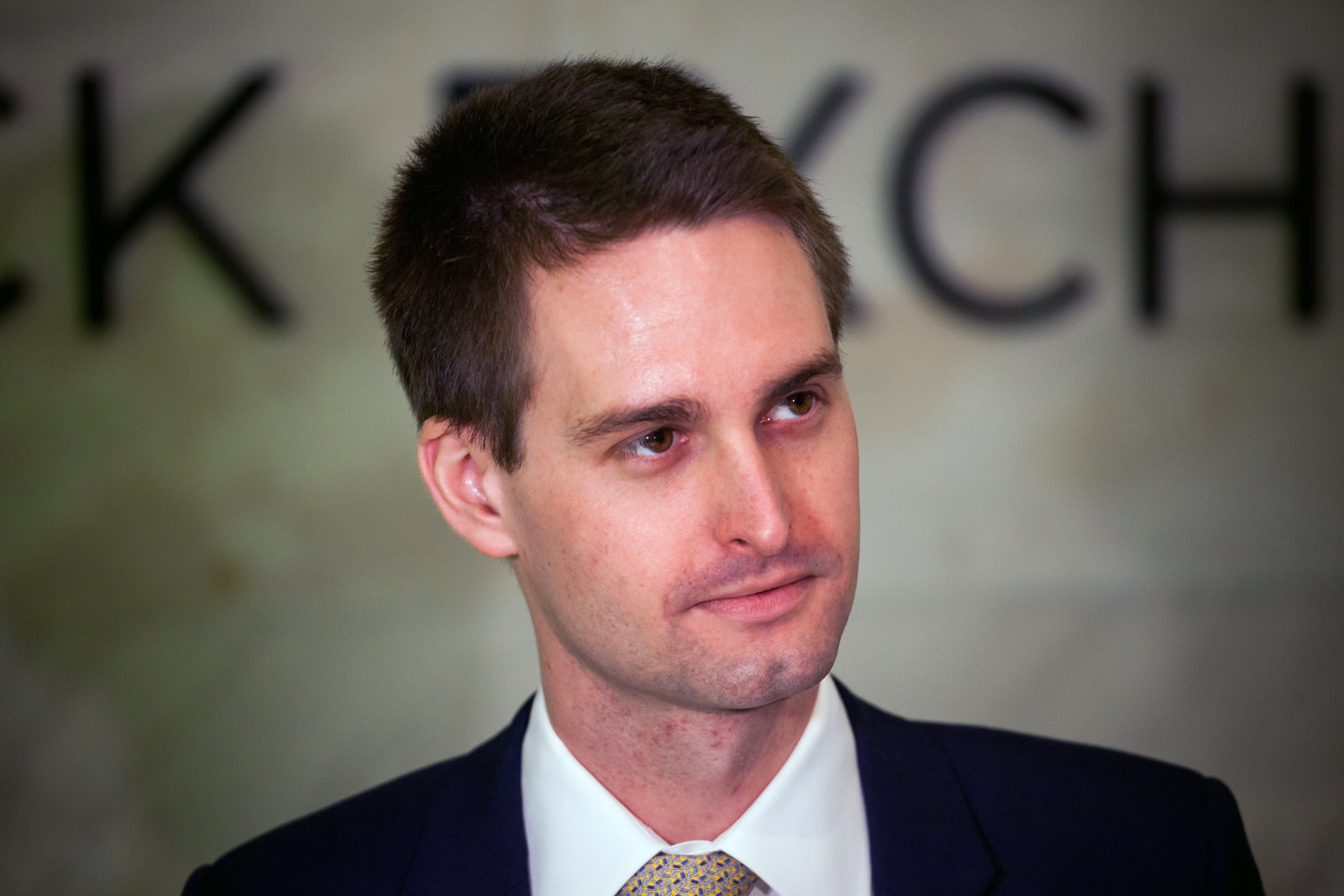 Evan Spiegel, co-founder and chief executive officer of Snap Inc., stands on the floor of the New York Stock Exchange (NYSE) during the company's initial public offering (IPO) in New York, U.S., on Thursday, March 2, 2017. Snap Inc., maker of the disappearing photo app that relies upon the fickle favor of millennials, jumped in its trading debut after pricing its initial public offering above the marketed range. Photographer: Michael Nagle/Bloomberg via Getty Images