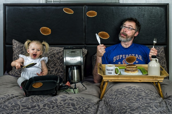 funny dads, best dads, dad flipping pancakes with daughter