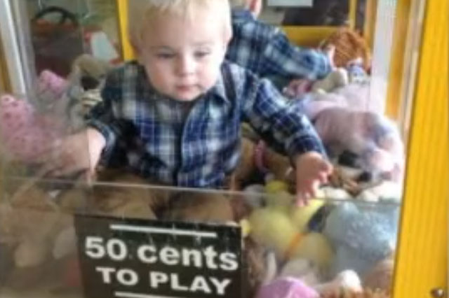 Toddler rescued after getting stuck inside a toy machine