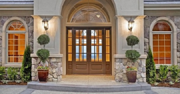enlarge the entryway by installing a door with windows on either side or above. This will add a sense of grandeur to the front of the house and create a more pleasant atmosphere inside, thanks to the added natural light.
