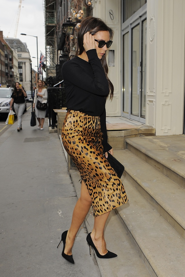 Victoria Beckham visits flagship London store in leopard-print Balmain skirt
