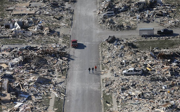 ADVANCE FOR USE SUNDAY, DEC. 22 AND THEREAFTER - FILE - This Monday, Nov. 18, 2013 aerial file photo shows people walking down a street where homes once stood that were destroyed by a tornado that hit the western Illinois town of Washington. Two dozen tornadoes swept through the state killing seven people. It was voted as one of the top 10 stories in Illinois for 2013. (AP Photo/Charles Rex Arbogast, File)