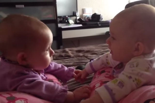 Twin babies set eyes on each other for the first time in very cute video