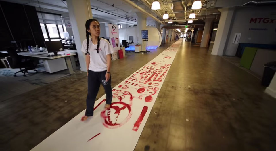 Artist paints a 328-foot-long line of code at Twitter's office