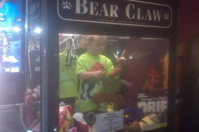 child trapped in claw machine