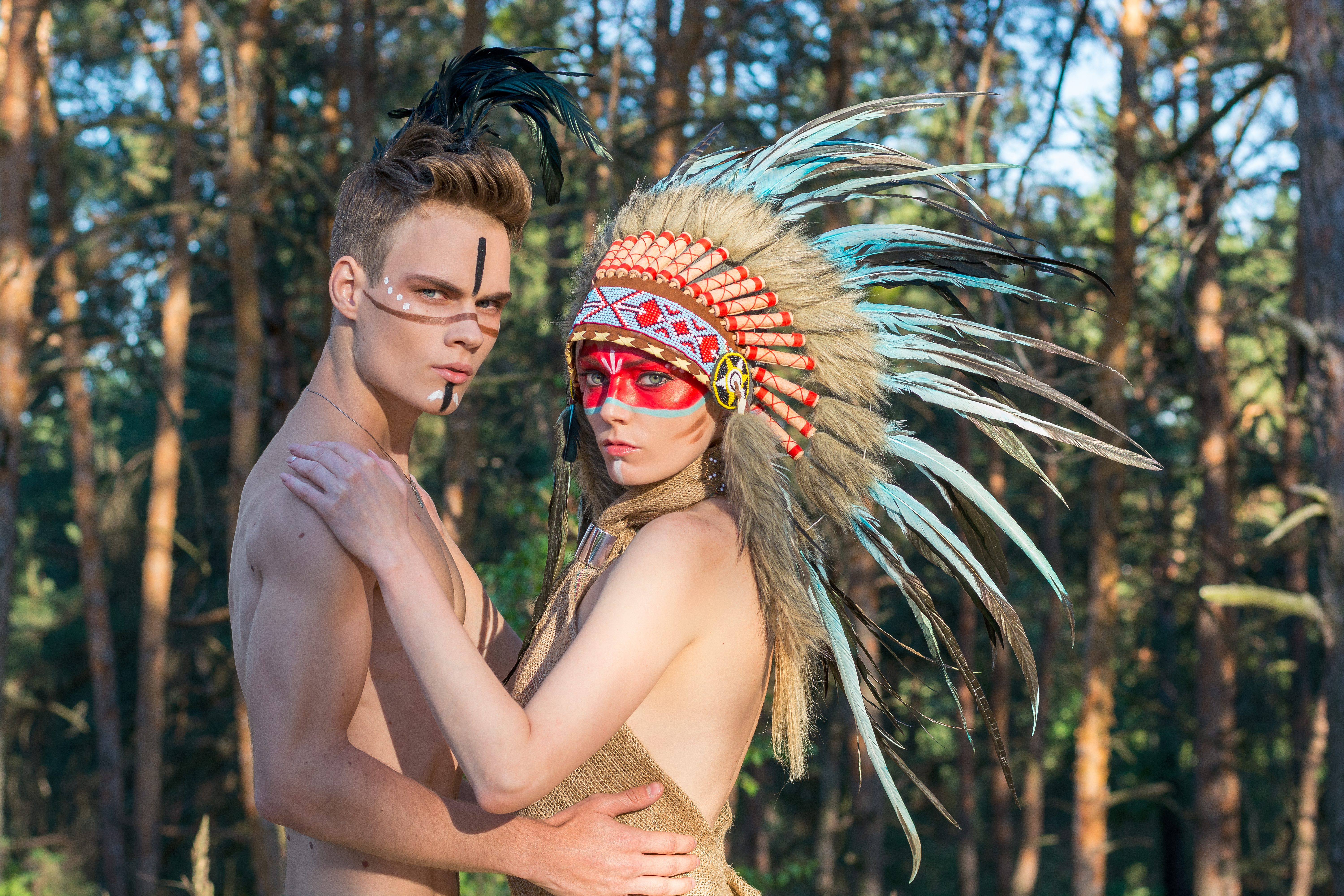 http://o.aolcdn.com/hss/storage/midas/2901793e615f9734824069f4ed0e759/205797657/man-with-an-american-indian-coloring-and-feathers-on-his-head-a-picture-id856966298