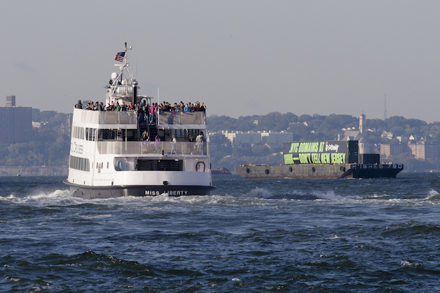 The GoDaddy barge travels up the Hudson River to promote the new .nyc internet domains, Wednesday, Oct. 8, 2014, in New York. (John Minchillo/AP Images for GoDaddy.)