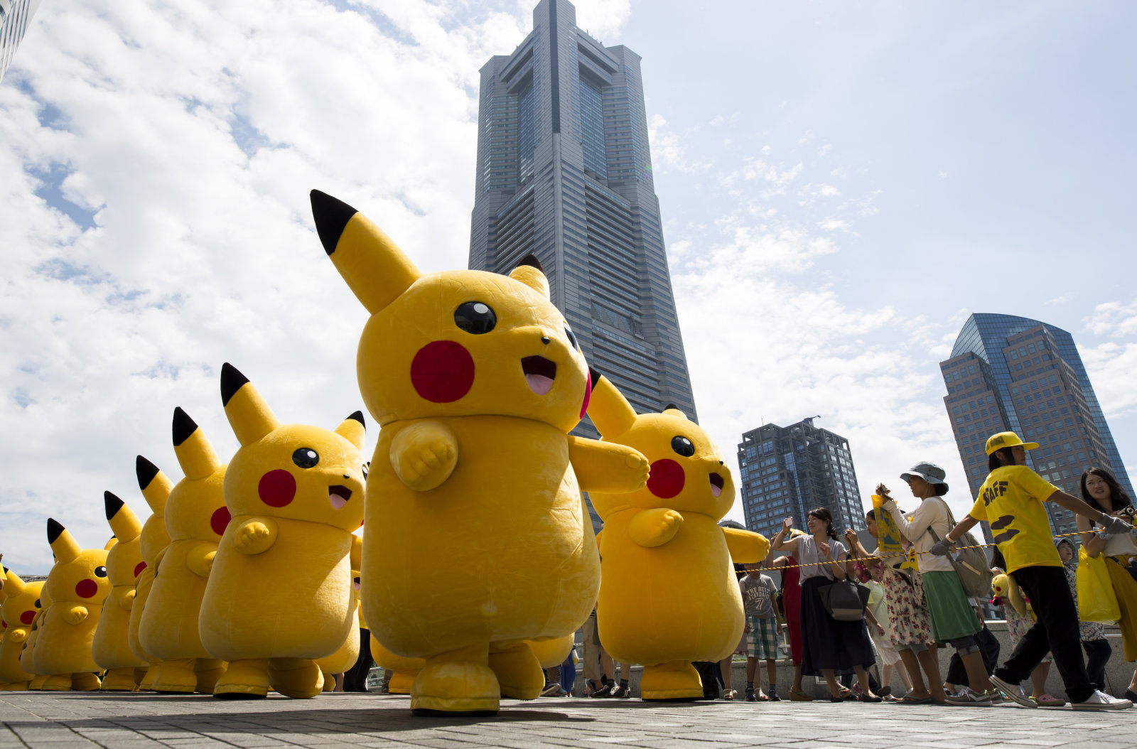 YOKOHAMA, JAPAN - AUGUST 09:  Performers dressed as Pikachu, a character from Pokemon series game titles, march during the Pikachu Outbreak event hosted by The Pokemon Co. on August 9, 2017 in Yokohama, Kanagawa, Japan. A total of 1, 500 Pikachus appear at the city's landmarks in the Minato Mirai area aiming to attract visitors and tourists to the city. The event will be held through until August 15.  (Photo by Tomohiro Ohsumi/Getty Images)