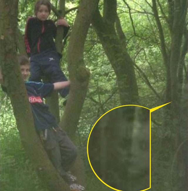 Mum spots ghost of 'black-eyed child' in family photo