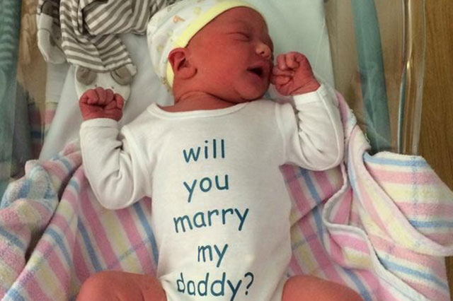 Dad enlists the help of newborn son to propose to mum minutes after his birth
