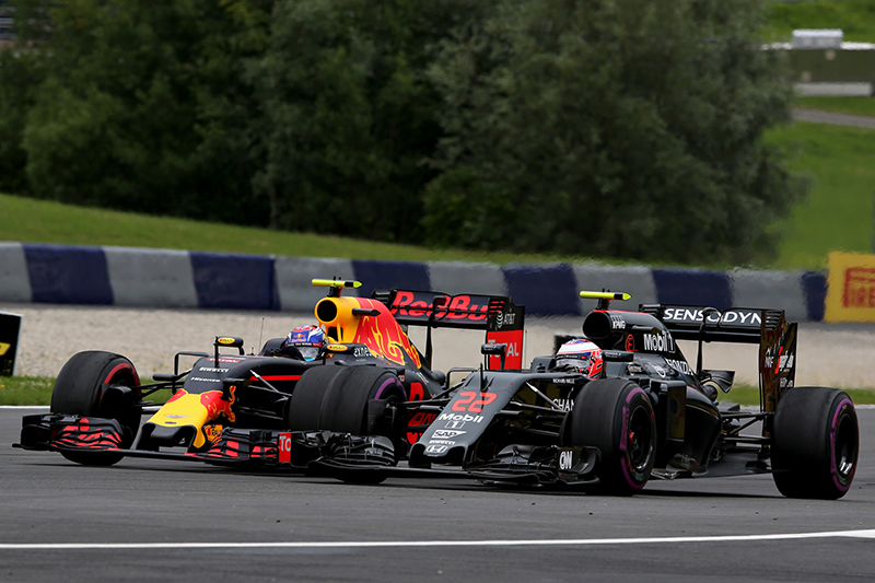 Max Verstappen of the Netherlands driving the (33) Red Bull Racing Red Bull-TAG Heuer RB12 TAG Heuer battles with Jenson Button of Great Britain driving the (22) McLaren Honda Formula 1 Team McLaren MP4-31 Honda RA616H Hybrid turbo on track during the Formula One Grand Prix of Austria at Red Bull Ring on July 3, 2016 in Spielberg, Austria.
