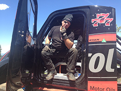 Racer Mike Ryan in his wrecked Freightliner hill climb special
