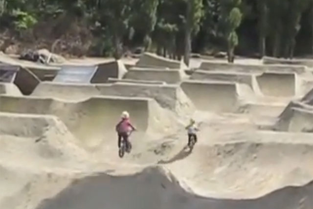 BMX riding brothers aged four