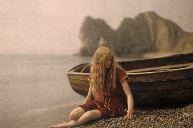 100-year-old colour photos show red-haired teenage girl in swimsuit on beach