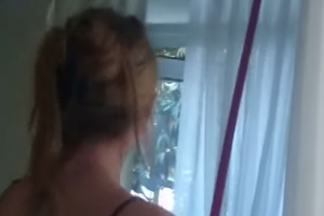 Mum's eardrum shattering reaction to spider on curtains (Video)