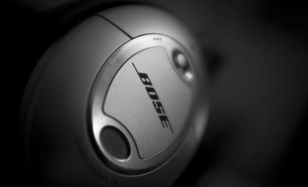 Bose headphones shrouded in darkness