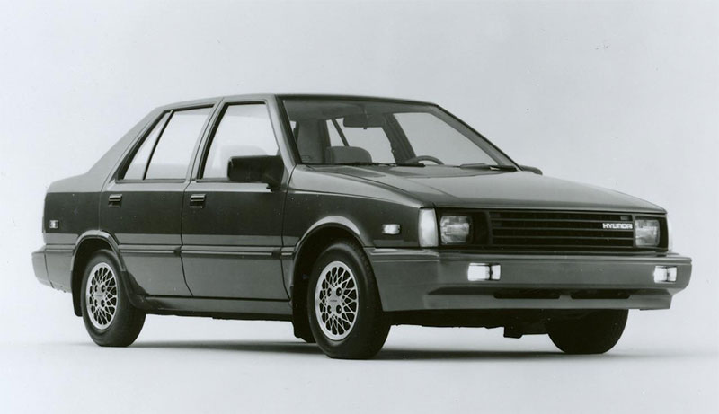 The 1986 Hyundai Excel, front three-quarter view.