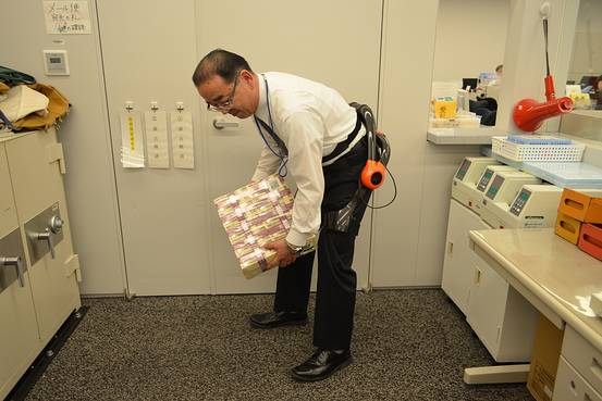 Japanese bankers get exosuits to help move stacks of cash