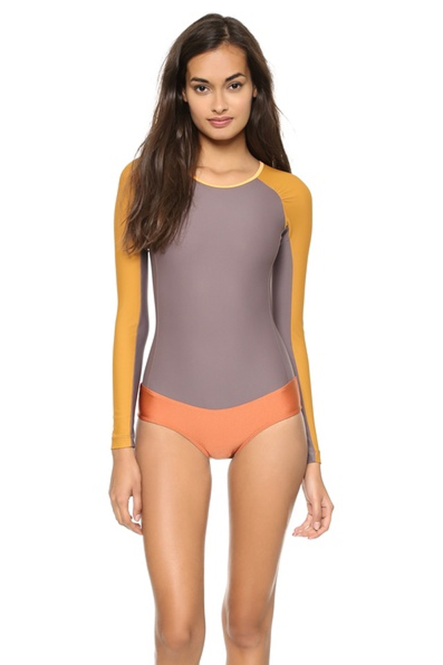Our high performance Long Sleeve Swimsuit with a fashionable front zip, sleek design and an ultra flattering shape is back in the hottest colors this season. This long sleeve bathing suit has sewn-in.