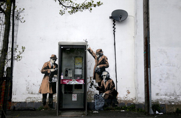 Reported Banksy graffiti showing eavesdroppers