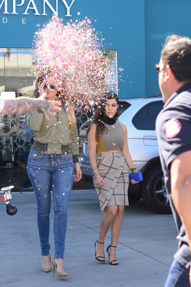Reality stars Kourtney and Khloe Kardashian get hit with a confetti bomb by Richie the Barber while filming scenes for 'Keeping Up With The Kardashians' at a rug store in West Hollywood, California on April 11, 2014. Afterwards Kourtney and Khloe's bodyguard held the tattooed barber to the side while he called the police. <P> Pictured: Khole Kardashian and Kourtney Kardashian <P><B>Ref: SPL737228  110414  </B><BR/> Picture by: Splash News<BR/> </P><P> <B>Splash News and Pictures</B><BR/> Los Angeles: 310-821-2666<BR/> New York: 212-619-2666<BR/> London: 870-934-2666<BR/> photodesk@splashnews.com<BR/> </P>
