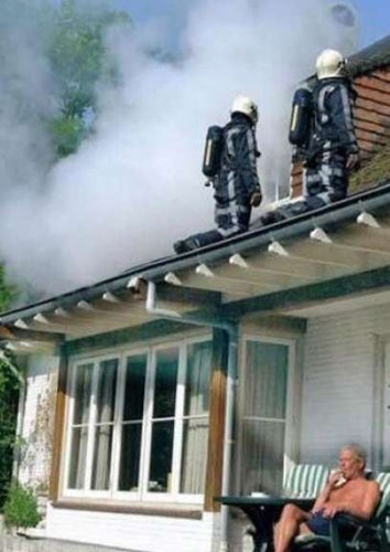 manliest photos on the internet, funny manly images, man smokes cigar as house burns