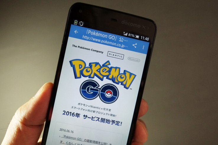 """This photo illustration taken in Tokyo on July 13, 2016 shows the Pokemon official site through a Japanese internet website announcing the latest information for """"Pokémon GO"""". With Pokemon-mania sweeping the planet, Nintendo's nascent shift into mobile gaming has proved a massive hit, vindicating the Japanese videogame giant's decision to unshackle itself from a long-standing consoles-only policy. / AFP / KAZUHIRO NOGI / TO GO WITH Japan-US-IT-Nintendo-Pokemon-lifestyle,FOCUS by Harumi OZAWA         (Photo credit should read KAZUHIRO NOGI/AFP/Getty Images)"""