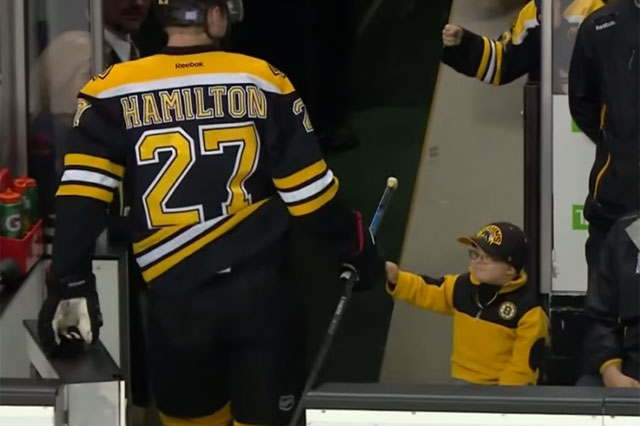bruins fan boy fist bump