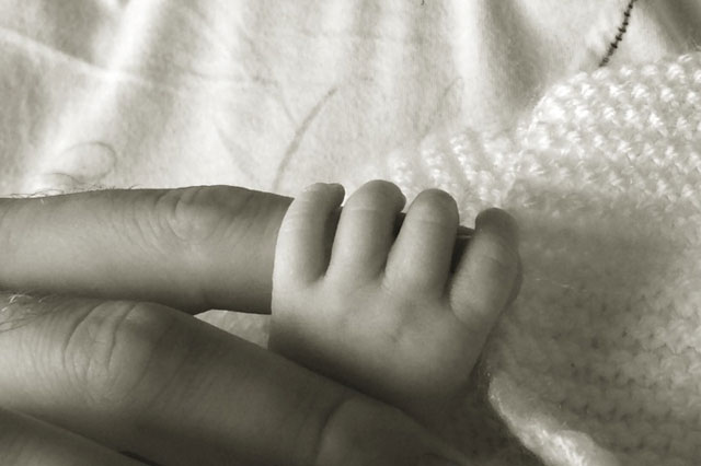 Katie Price baby: Photo shows newborn daughter clutching dad Kieran Hayler's finger