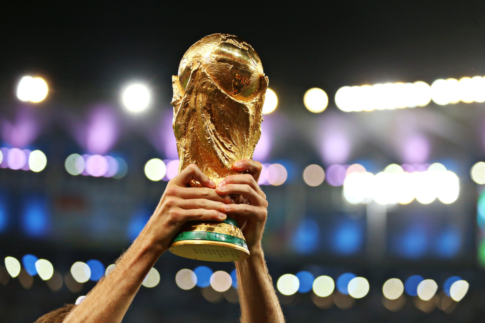 File photo dated 13/07/14 of a player lifting the FIFA World Cup Trophy, as the tournament in Russia is set to start on the 14th June.