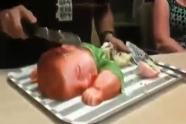 Man slicing up baby-shaped cake will make you shudder (video)