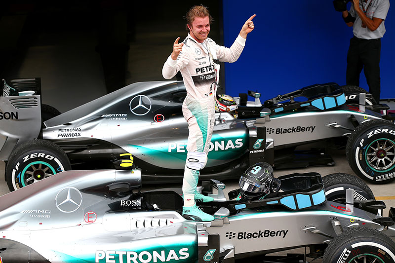 Nico Rosberg stands atop his car after winning the 2015 Brazilian Grand Prix.