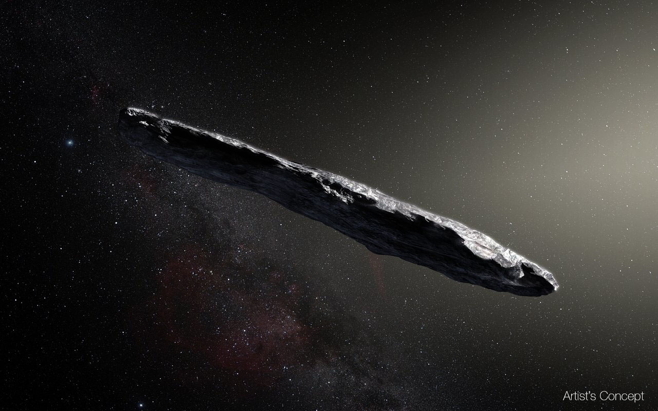 This artist's impression shows the first interstellar asteroid: `Oumuamua. This unique object was discovered on 19 October 2017 by the Pan-STARRS 1 telescope in Hawai`i. Subsequent observations from ESO's Very Large Telescope in Chile and other observatories around the world show that it was travelling through space for millions of years before its chance encounter with our star system. `Oumuamua seems to be a dark red highly-elongated metallic or rocky object, about 400 metres long, and is unlike anything normally found in the Solar System.