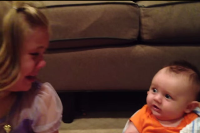 This adorable girl really does not want her baby brother to grow up