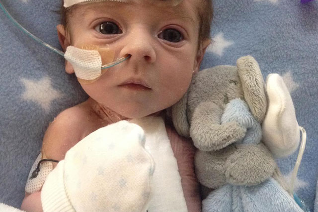 Baby born with half a heart back home after nine operations