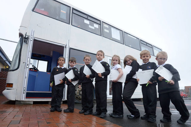 School buys old bus on eBay to ease overcrowded classrooms