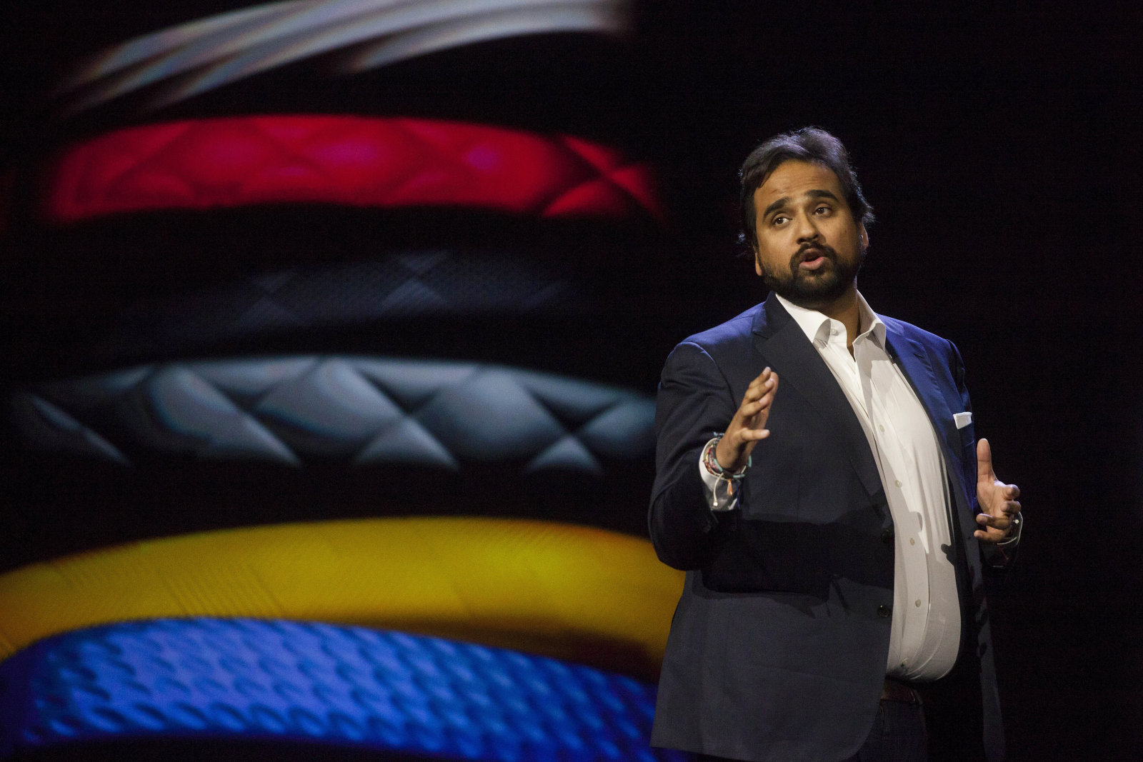 Hosain Rahman, chief executive officer of Jawbone Inc., speaks at a news conference during the 2015 Consumer Electronics Show (CES) in Las Vegas, Nevada, U.S., on Monday, Jan. 5, 2015. This year's CES will be packed with a wide array of gadgets such as drones, connected cars, a range of smart home technology designed to make everyday life more convenient and quantum dot televisions, which promise better color and lower electricity use in giant screens. Photographer: Michael Nagle/Bloomberg via Getty Images