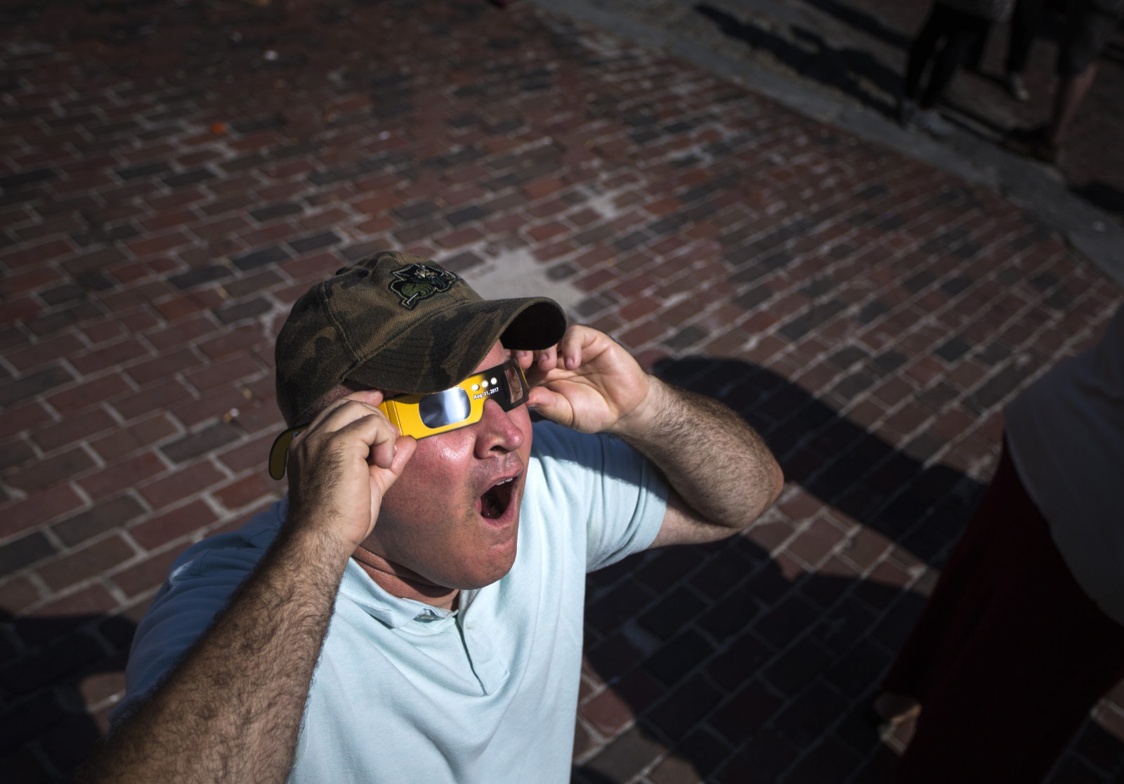 PORTLAND, ME - AUGUST 21: Glenn Shelton of Portland uses solar glasses to view the eclipse at Monument Square. (Staff photo by Derek Davis/Portland Press Herald via Getty Images)