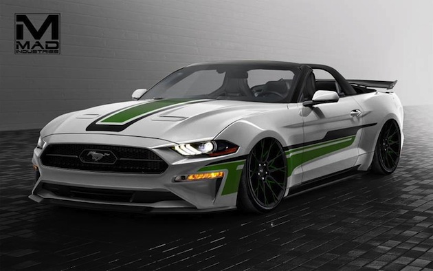 This 2018 Ford Mustang Convertible by MAD Industries enhances Mustang's aggressive new look with dramatic eye appeal for a dynamic top-down adventure. This world-class luxury sports car is outfitted with staggered 20-inch Niche Staccato Wheels. APR Carbon Fiber Drag Wing provides the down force and aggressive look. A re-tuned 2.3-liter EcoBoost® engine with Ford Performance intake and exhaust enhance power. Inside, the cockpit artfully blends white details from the exterior theme and Braum Elite-X Series Racing bucket seats detailed in white stitching.